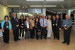 Dr. Chezy Levy, Mrs. Marcie Natan and members of the delegation at patient bedside