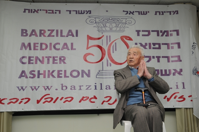 Dr. Michael Lavy talking to the guests about the establishment of the center